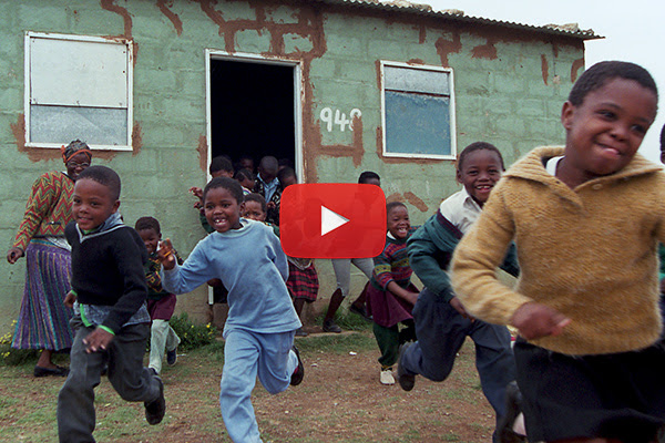 Children running outside of a building