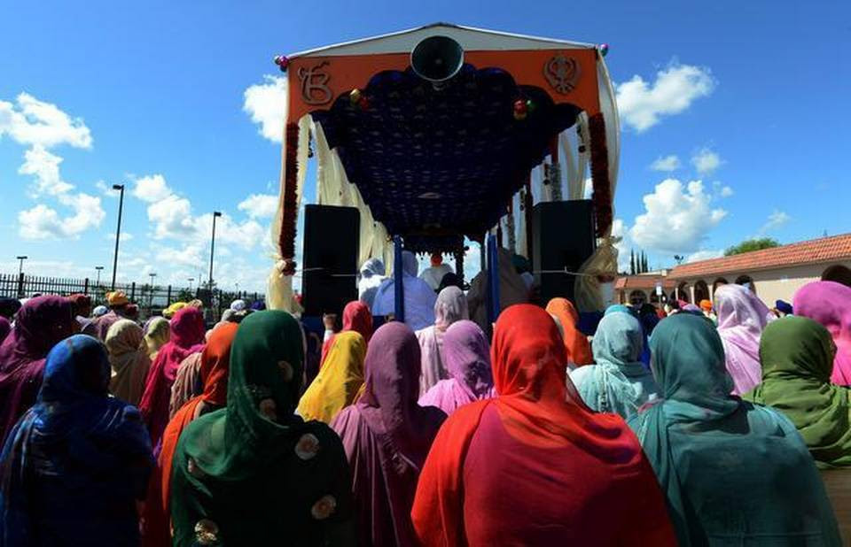 Hundreds of Sikhs march alongside the float bearing Guru Granth Sahib on Peach Avenue during last year's parade in Livingston.