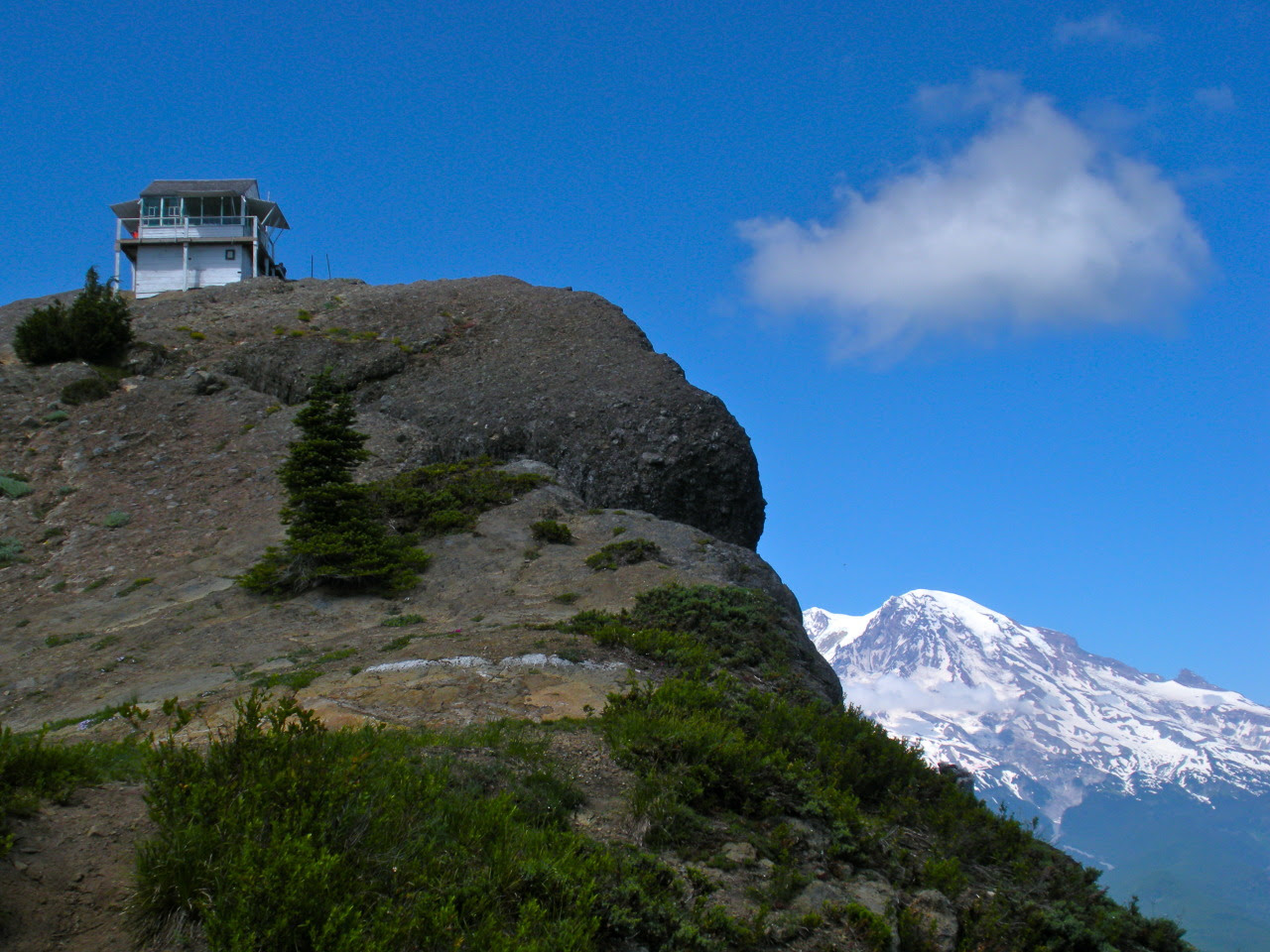 "High Rock Look Out near Ashford, Washington A plaque reads: """"In loving memory of Johnnie T. Peters who packed materials by mule from Mineral in 1930 to build namely this lookout, High Rock, and 10 others in the Mineral, Packwood, and Randle..."
