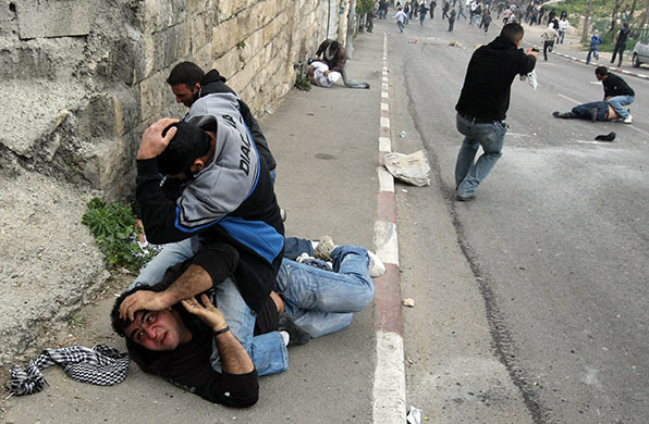East Jerusalem protests: Undercover Israeli police officers detain Palestinian demonstrators