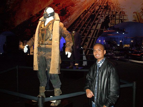 Posing with the Bane outfit worn by Tom Hardy in THE DARK KNIGHT RISES, on December 7, 2012.
