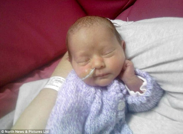 Beautiful: Hannah is pictured wrapped in her mother's arms. She was born at Borders General Hospital in Melrose