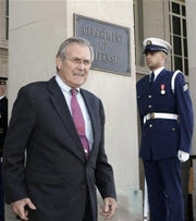 Reuters Photo: U.S. Secretary of Defense Donald Rumsfeld stands on the steps of the Pentagon in Washington...