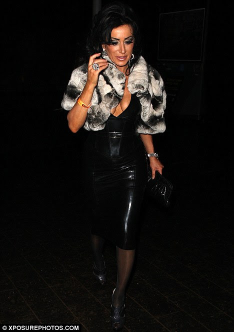 Causing a stir: Nancy Dell'Olio stepped out in Liverpool last night wearing a daring low-cut PVC dress
