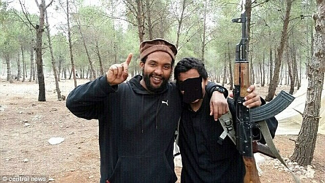 Aine Davis, (left) originally from Hammersmith, poses with weapons in Syria