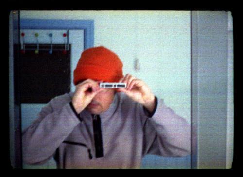 reflected self-portrait with Yashica Atoron camera and orange hat by pho-Tony