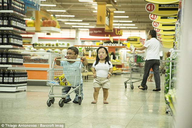 After eight years together, Paulo and Katyucia - pictured at the supermarket with an adapted trolley - are preparing their wedding