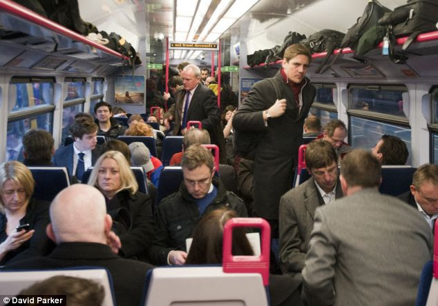 Standard class: Commuters packed in on the 07.44 Great Western train from Henley on Thames to Paddington