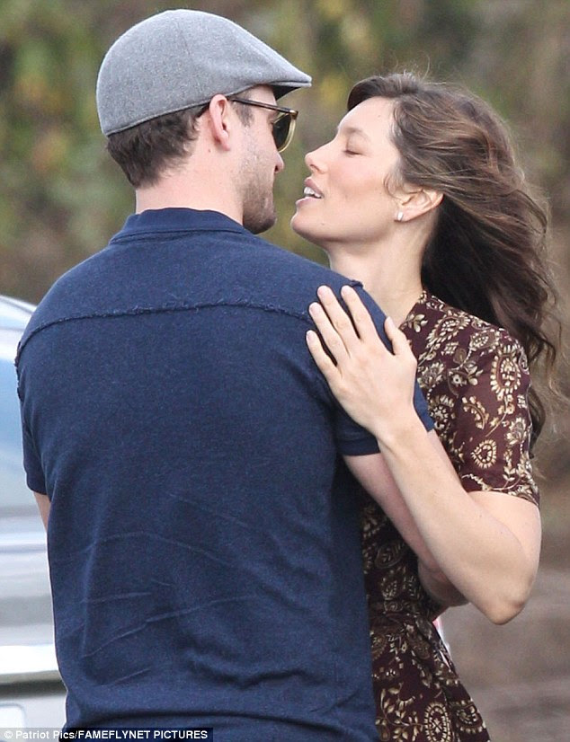 Cute couple: Justin and Jessica hugged and kissed before heading to her trailer