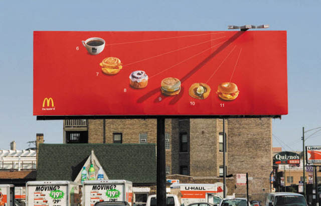 mcdonalds billboard like sundial shows different food for different time of day