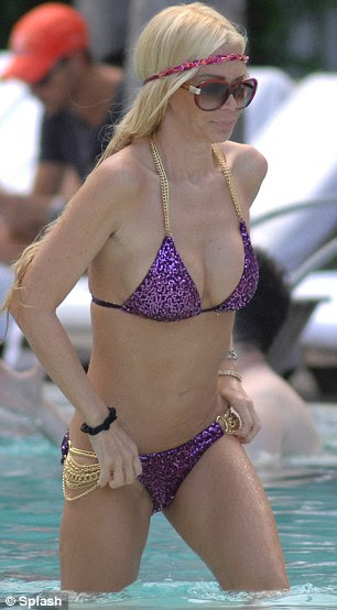 Adjustment: The 37-year-old entrepreneur adjusted her bikini bottoms and top to protect her modesty as she left the pool