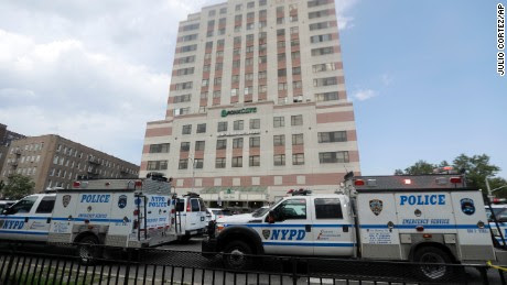 Police vehicles converge on Bronx Lebanon Hospital in New York after a gunman opened fire there on Friday, June 30, 2017. The gunman, identified as Dr. Henry Bello who used to work at the hospital, apparently took his own life after shooting others, authorities said. (AP Photo/Julio Cortez)