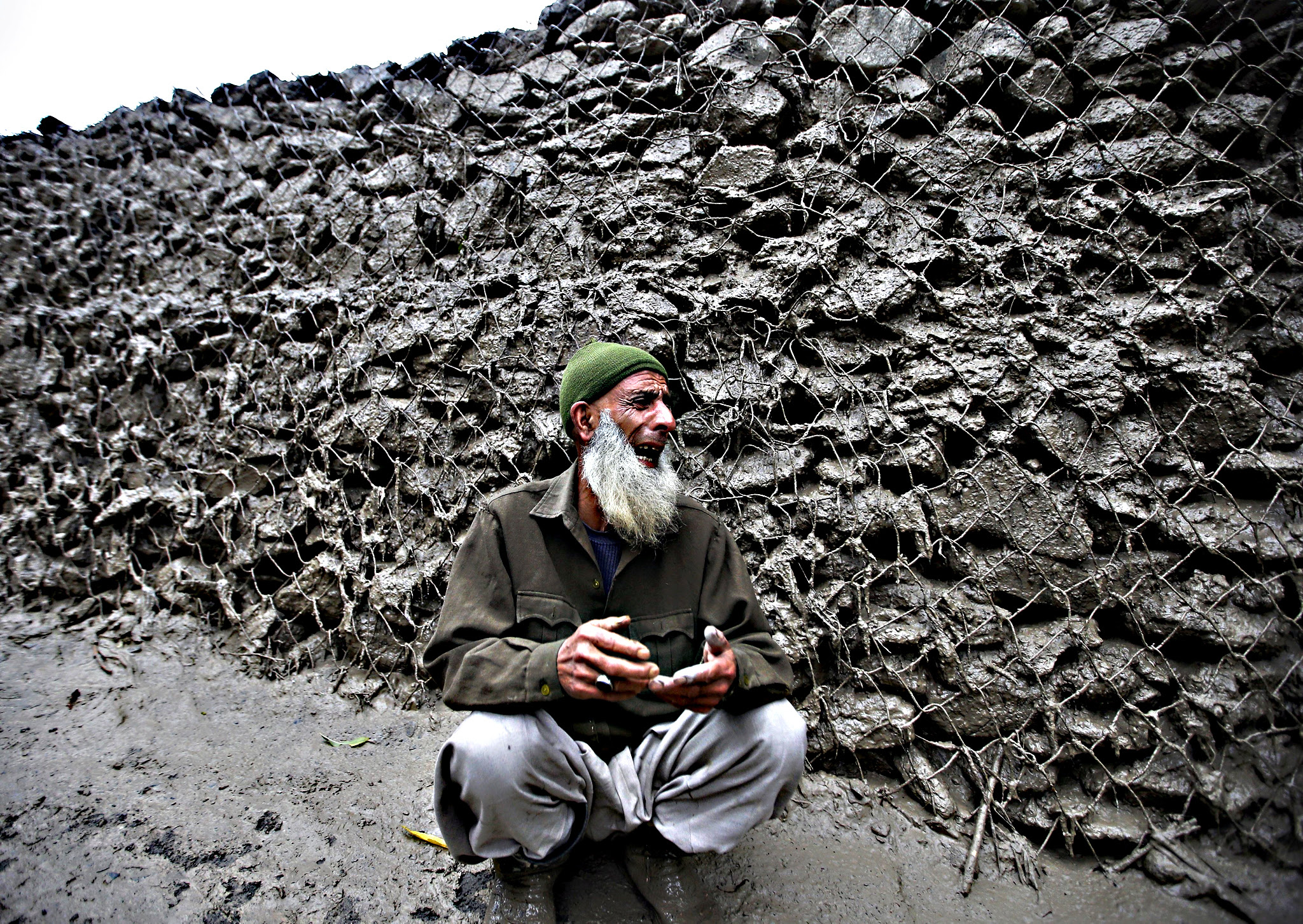 A Kashmiri villager cries for his missing relative after a cloud burst at Kullan village in Ganderbal district, on Friday. At least four people were killed in a series of cloud bursts that were reported from several parts of Kashmir during heavy rainfall, local media reported on Friday