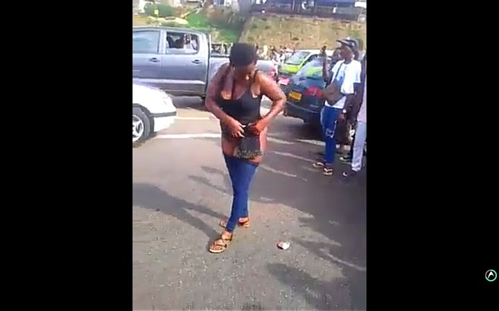 Woman Hits Middle Of Highway, Strips Unclad & Dances As People Take Photos