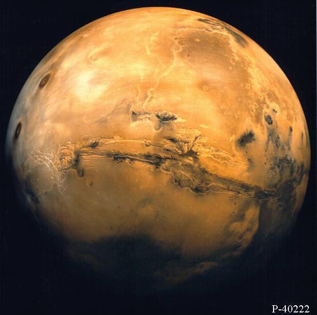 Mars from orbit.  Valles Marineris and Volcanic region