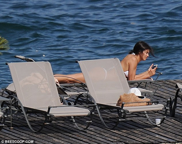Updates: Irina couldn't switch off completely as she stopped to check her phone