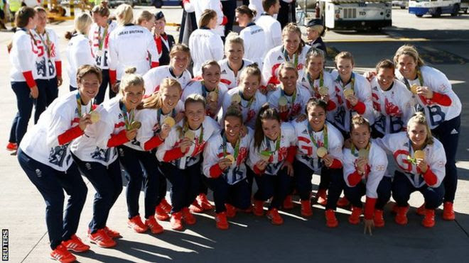 GB's women's hockey team pose with their gold medals