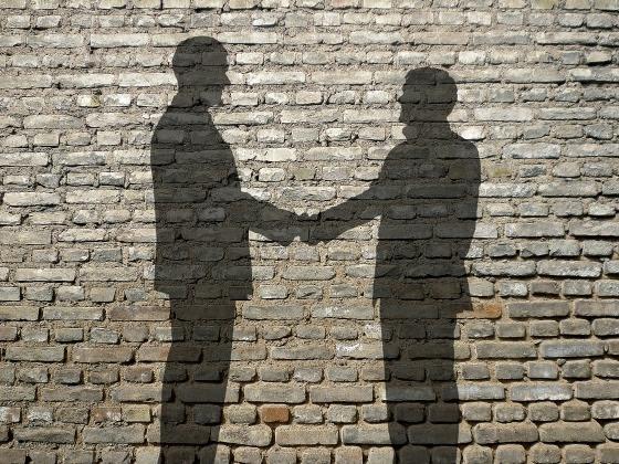deal secret blackmail handshake