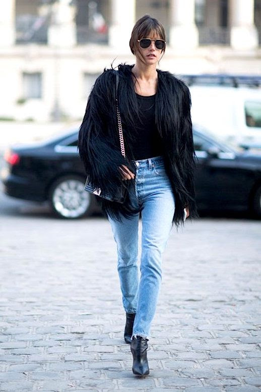 Le Fashion Blog Alessandra Ambrosio Fashion Week Black Fur Coat Raw Hem Jeans Black Boots Via Vogue