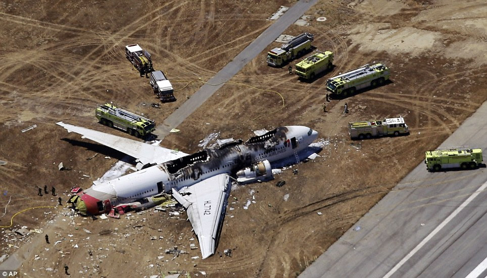 What went wrong? Firecrews work to contain flames after a plane skidded onto a dirt area at San Francisco Airport on Saturday, killing two. Investigations are now underway to determine the cause