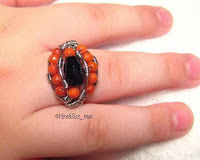 wire wrapped ethnic ring around finger