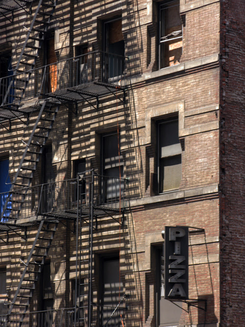 old sign on old building, west side of Manhattan, NYC