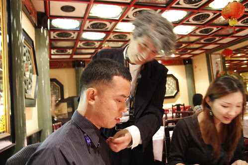 Prof Ando teaching Ming Jin how to wear his (Prof Ando's) bow tie