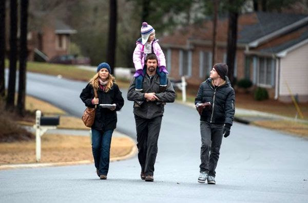 Keller Dover (Hugh Jackman), his wife Grace (Maria Bello) and their two kids walk down the street to a neighbor's party in PRISONERS.
