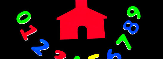 Little red school house with colorful numbers