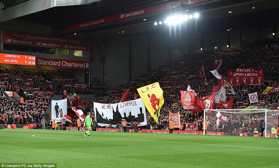 The Kop get behind their side in the first half as Loris Karius makes his way to his goal prior to kick off at Anfield