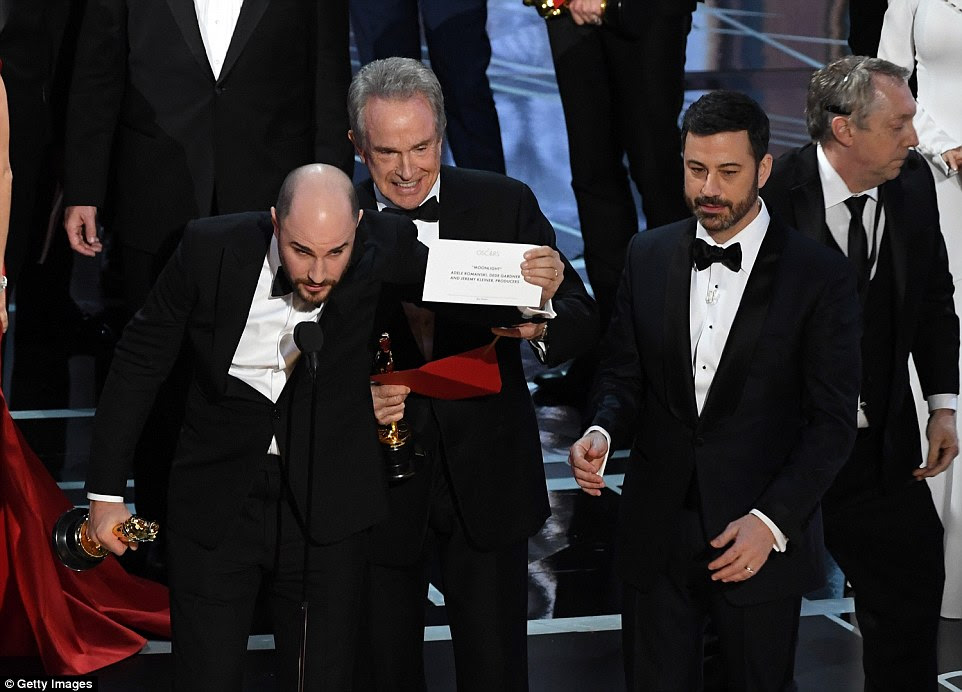 Announcers Warren Beatty (center) and Faye Dunaway were given the wrong card, causing the mix-up. La La Land's producers were informed on stage as they were giving their acceptance speeches. Producer Jordan Horowitz, left, eventually spoke up and revealed that Moonlight was the real winner