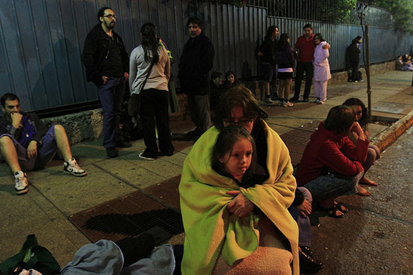 Chile Earthquake: People gather on a street of downtown Santiago after an earthquake