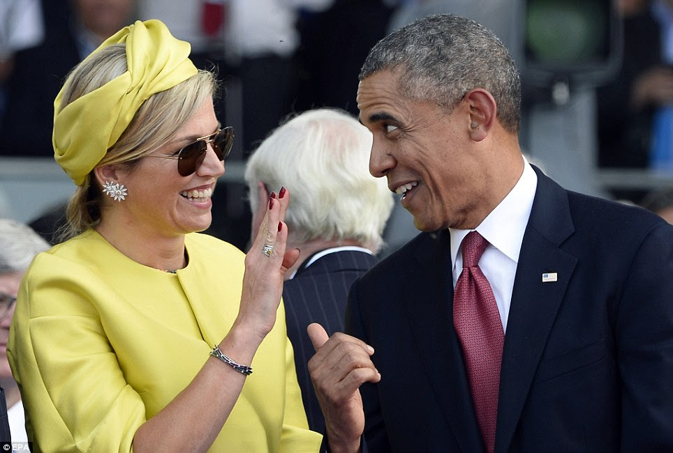 Kidding around: President Obama has a laugh with Queen Maxima of e Netherlands at the international D-Day commemoration ceremony in Ouistreham, France