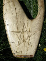 Custom 15 string Kinnor. Myrtle wood with Spruce sound board. Five pointed stars, and inset natural rounded quartz pieces inset intot eh wood surface