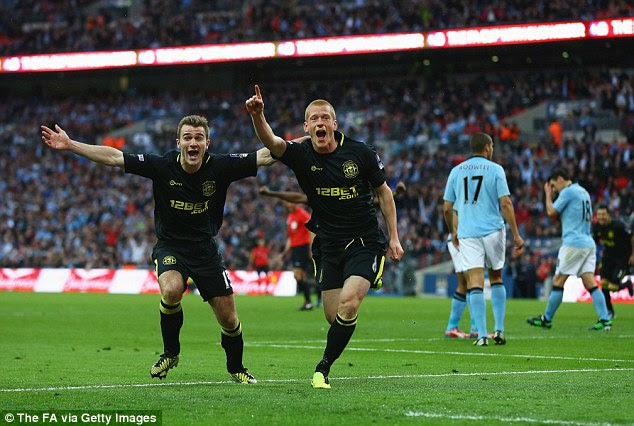 Delight: Ben Watson headed home in the last minute as Wigan wont heir first ever FA Cup in dramatic style