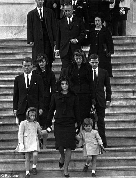 Solemn: Mrs Kennedy, holding the hands of her children, leads the funeral procession from the U.S. Capitol on November 24, 1963