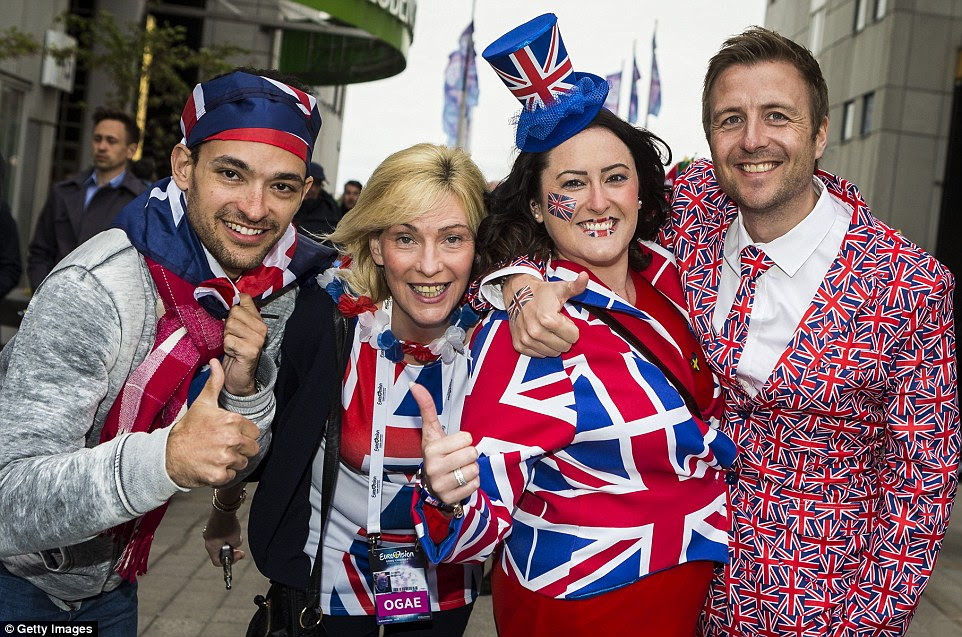 Patriotic! British supporters beamed as they posed in a flurry of Union Jack emblazoned top hats and shirts