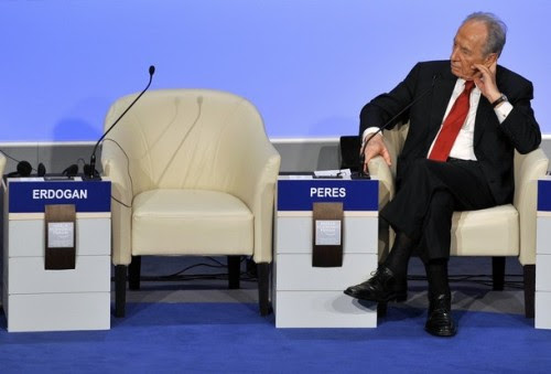 Israeli President Shimon Peres listens near the empty seat of Turkish Prime Minister Recep Tayyip Erdogan after Erdogan stormed out of a debate with  Peres about the Gaza war at the Davos forum on January 29, 2009.   AFP PHOTO FABRICE COFFRINI (Photo credit should read FABRICE COFFRINI/AFP/Getty Images)