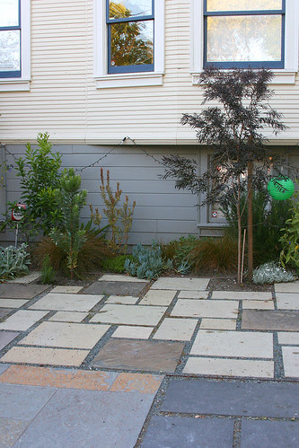ecclectic patio and interesting plantings