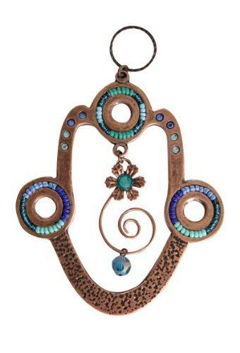 Hamsa Wall Hanging with Blue Beads and Rhinestones by World of Judaica. $50.00. Add a touch of style to your home decor while providing evil eye protection, with this hamsa wall hanging featuring blue beading with a spiral and single flower hanging from the center.