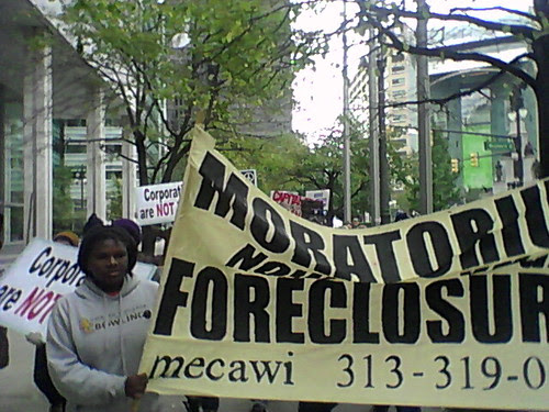 "Activists from ""Occupy Detroit"" marching on Woodward Avenue through the financial district to Bank of America demanding a moratorium on foreclosures. Demonstrations have been held since October 14, 2011. (Photo: Abayomi Azikiwe) by Pan-African News Wire File Photos"