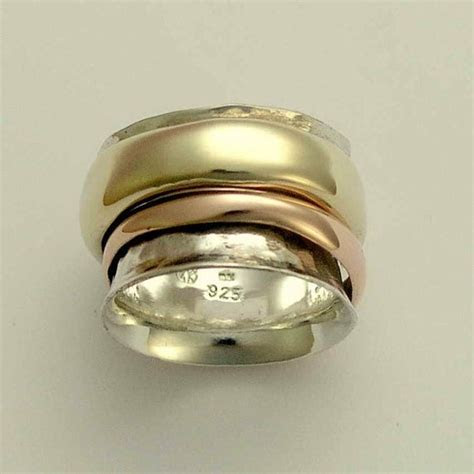 Spinner ring   Sterling silver with yellow and rose gold