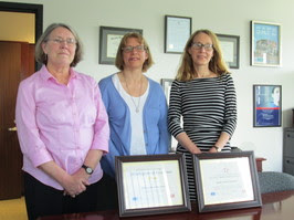 Cancer Registry staff pose with awards