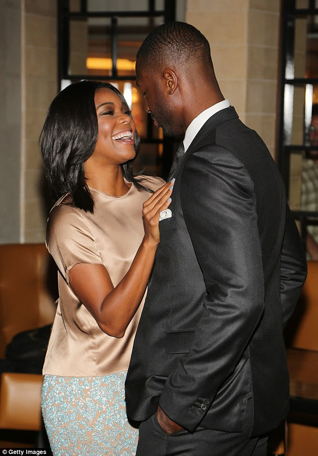 Look of love: Gabrielle was all smiles as she proudly stood by her Miami Heat star husband