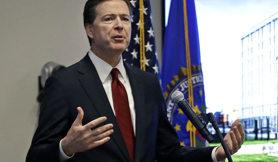 FBI Director James Comey speaks during a ceremony in Chelsea, Mass., Tuesday, March 7, 2017, to mark the opening of new offices of the FBI's Boston division. (AP Photo/Elise Amendola)