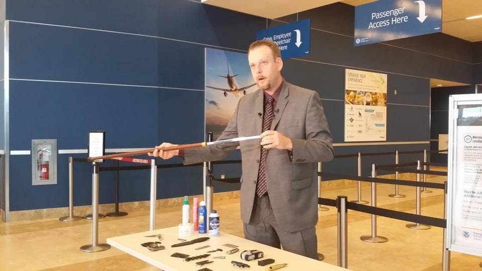 TSA official Mark Howell shows how a sword was almost carried onto a flight out of Myrtle Beach International Airport. It was hidden inside the cane.