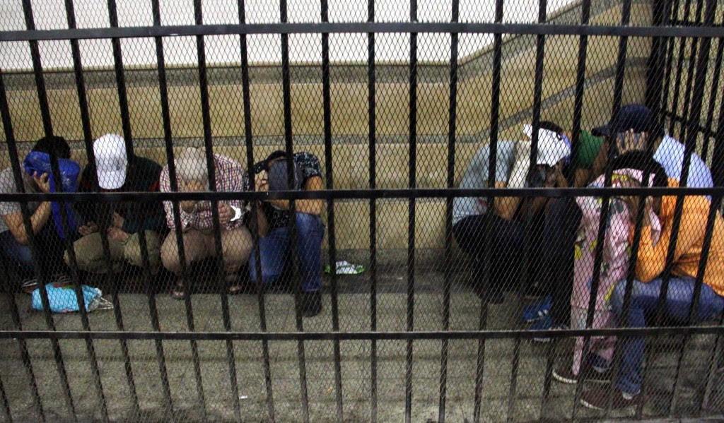 Eight people sentenced to three years in jail after joining an illegal gay wedding ceremony are seen behind the bars in Cairo, Egypt, on November 1, 2014. The men were found guilty of spreading 'indecent images' and 'inciting debauchery' over a video that appeared to show them celebrating a gay marriage in Cairo. (Photo by Stringer/Anadolu Agency/Getty Images)