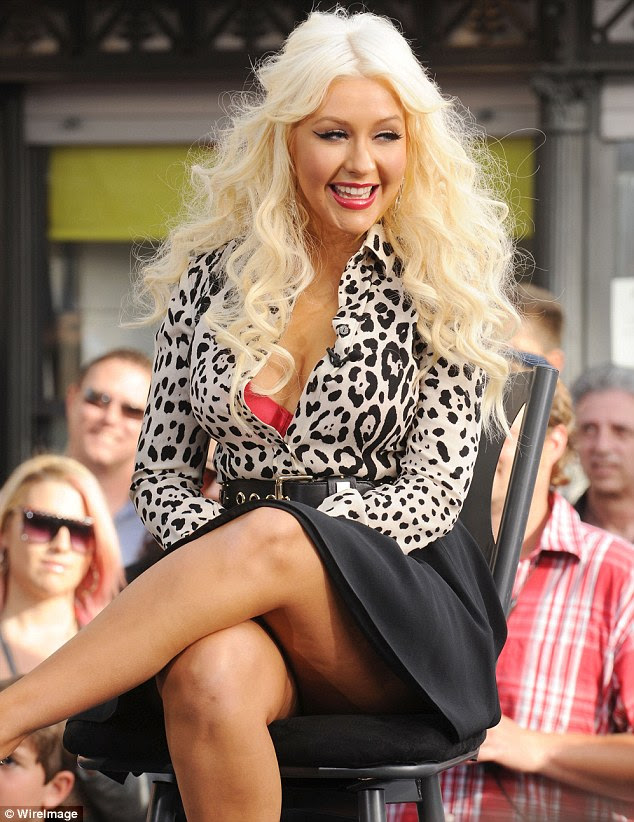 Dreaded cellulite: Christina Aguilera revealed 'orange peel' legs at an appearance for Extra The Grove in LA today