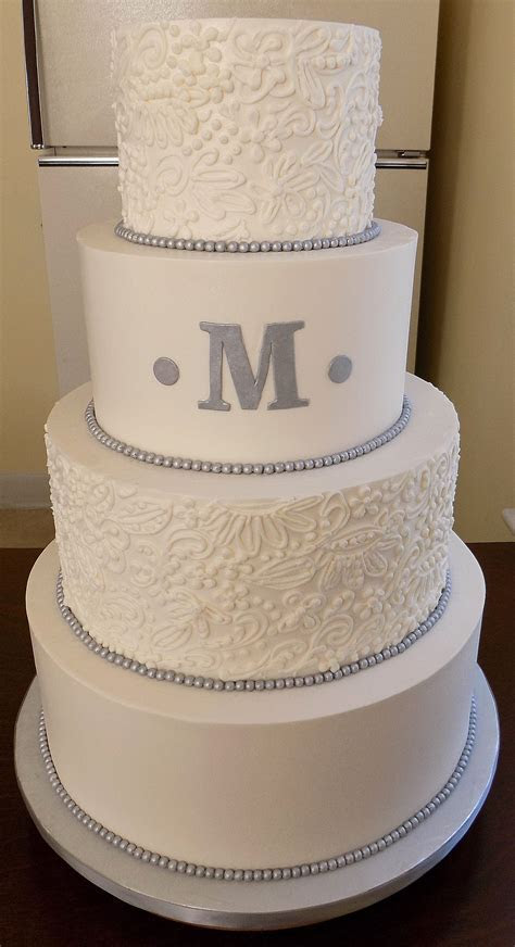4 Tier buttercream wedding cake, decorated with