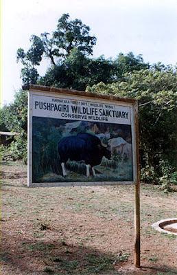A board depicting Pushpagiri wildlife sanctuary in Kodagu (Coorg) District along the trek to Kumara Parvata peak from Beedihalli